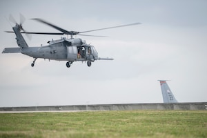 A U.S. Air Force HH-60 Pave Hawk, assigned to the 33rd Rescue Squadron, lifts off for a regular training mission April 3, 2020, at Kadena Air Base, Japan. The HH-60G Pave Hawk, or Precision Avionics Vectoring Equipment, has a hoist that can lift up to 600 pounds during personnel recovery operations. (U.S. Air Force photo by Senior Airman Rhett Isbell)