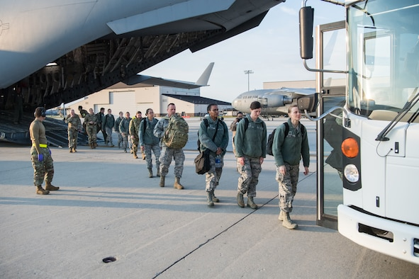 U.S. Reserve Citizen Airmen with medical experience offload from a C-17 Globemaster III with the 911th Airlift Wing at Joint Base McGuire-Dix-Lakehurst, N.J., on their way to support the residents of New York City in the fight against COVID-19, April 5, 2020.