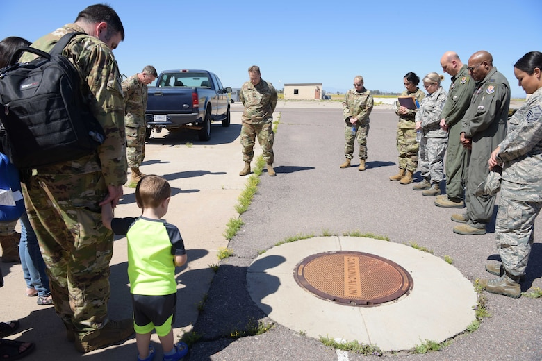 Maj. David Kreis, 944th Fighter Wing chaplain, prays for mobilized Air Force Reserve medics before they board their airlift in support of the COVID-19 pandemic at Luke Air Force Base, Ariz., April 5, 2020. This deployment is part of a larger mobilization package of more than 120 doctors, nurses, and respiratory technicians. Air Force Reserve units across the nation provided over the past 48 hours in support of the COVID-19 response to take care of Americans.