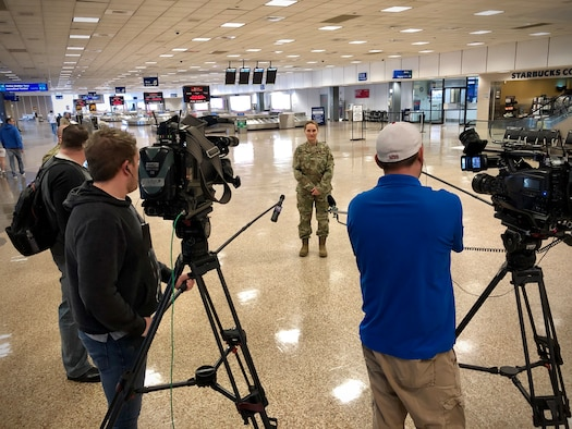 Maj. Katherine Trout, a medic with the 419th Fighter Wing, is interviewed by local news media today at the nearly empty Salt Lake City airport just prior to departing on a flight to the New York City area where she will assist with the city's COVID-19 response