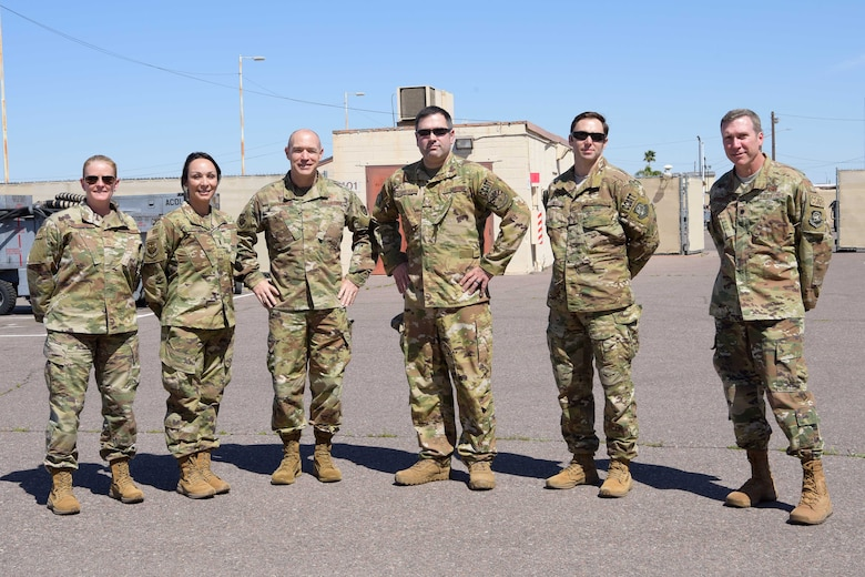 Mobilized Air Force Reserve medics pose for a photo with their leaderships before they board their airlift in support of the COVID-19 pandemic at Luke Air Force Base, Ariz., April 5, 2020. This deployment is part of a larger mobilization package of more than 120 doctors, nurses and respiratory technicians Air Force Reserve units across the nation provided over the past 48 hours in support of the COVID-19 response to take care of Americans.