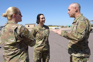 1st Lt. Danielle Clark, 944th Aeromedical Staging Squadron clinical nurse, talks with the 944th Fighter Wing commander, Col. James Greenwald, as the 944 FW Command Chief, Chief Master Sgt. Catherine Buchanan, listens in before Clark departs in support of the COVID-19 pandemic at Luke Air Force Base, Ariz., April 5, 2020. This deployment is part of a larger mobilization package of more than 120 doctors, nurses, and respiratory technicians. Air Force Reserve units across the nation provided over the past 48 hours in support of the COVID-19 response to take care of Americans.