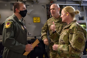 Major Avram Aaron Brammostyn, 944th Aeromedical Staging Squadron flight surgeon, checks in with the 944th Fighter Wing Commander, Col. James Greenwald, and the 944th FW Command Chief, Chief Master Sgt. Catherine Buchanan, before his takes off in support of the COVID-19 pandemic at Luke Air Force Base, Ariz., April 5, 2020. This deployment is part of a larger mobilization package of more than 120 doctors, nurses and respiratory technicians Air Force Reserve units across the nation provided over the past 48 hours in support of the COVID-19 response to take care of Americans.