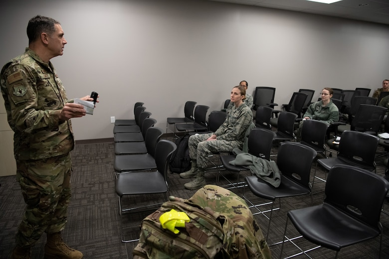 Col. Raymond A. Smith, Jr., 445th Airlift Wing commander, briefs deploying members from the 445th Airlift Wing's Aerospace Medicine and Aeromedical Staging Squadrons, during out-processing here April 5, 2020.  Airmen from the 445th Airlift Wing were notified April 4, 2020 that they would be mobilized to New York City to help with the COVID-19 pandemic. The Citizen Airmen will join other military personnel providing medical services at the Jacob Javits Center in New York City. This deployment is part of a larger mobilization package of more than 120 doctors, nurses and respiratory technicians Air Force Reserve units across the nation provided over the past 48 hours in support of COVID-19 response to take care of Americans.  (U.S. Air Force photo/Mr. Patrick O'Reilly)