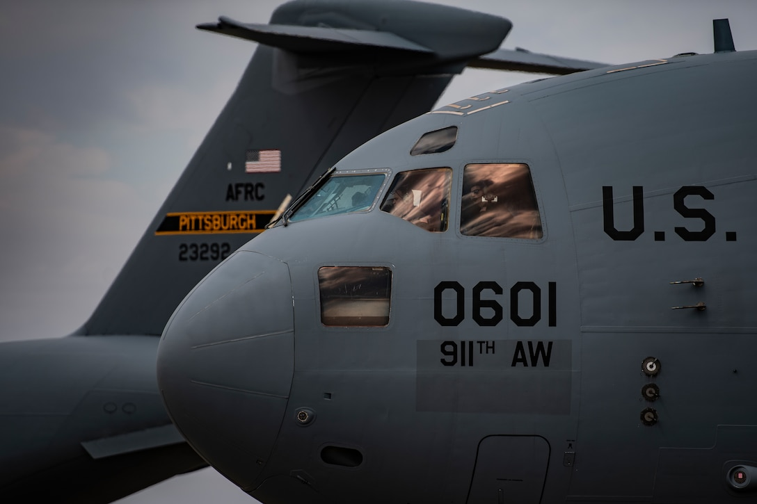 911th Airlift Wing aircrew members prepare to transport mobilized Airmen from Pittsburgh International Airport Air Reserve Station, Pennsylvania, to Joint Base McGuire-Dix-Lakehurst, New Jersey, in support of the COVID-19 efforts in early April.  (Joshua J. Seybert)
