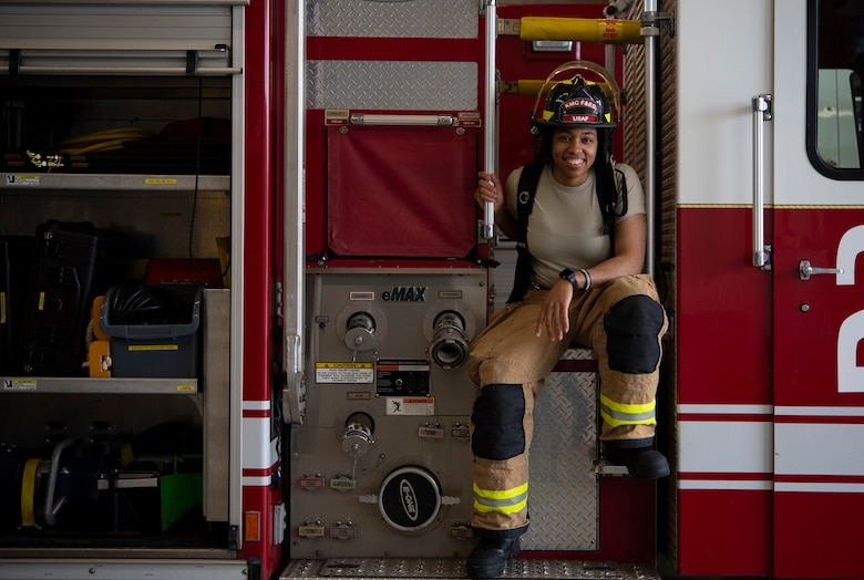 A photo of U.S. Air Force Airman 1st Class Kayla Jerido, 86th Civil Engineer Squadron fire protection apprentice, sitting on a fire truck at Vogelweh Military Complex, Germany, March 12, 2020.