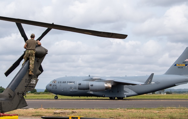 U.S. Army Sgt. Christian Villegas, 82nd Combat Aviation Brigade (CAB), 3rd Battalion crew chief, assembles the tail rotor blades of a UH-60L Blackhawk at Moi International Airport, Mombasa, Kenya on March 1, 2020.