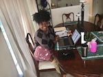 Melody Arnold, a DLA Troop Support Audit Readiness and Compliance business process analyst, poses for a photo at her remote workstation from home April 3, 2020.