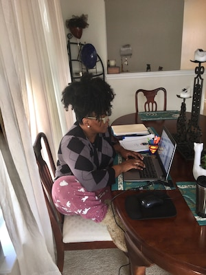 Melody Arnold, a DLA Troop Support Audit Readiness and Compliance business process analyst, works at her remote workstation at home April 3, 2020.