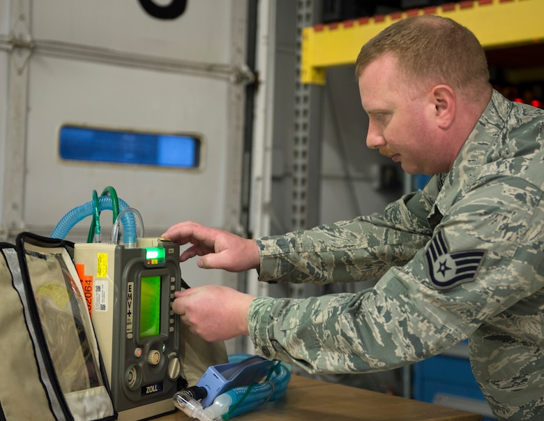 U.S. Air Force Staff Sgt. William Vievering, 133rd Chemical, Biological, Radiological and Nuclear Defense (CBRN) Enhanced Response Force Package, checks the Zoll 731 Ventilators after being calibrate in St. Paul, Minn., Mar., 19, 2020.