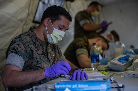 U.S. Navy Sailors with 2nd Medical Battalion, 2nd Marine Logistics Group pre-screen Marines with 2nd Light Armored Reconnaissance Battalion, 2nd Marine Division, on Marine Corps Air Station Cherry Point, N.C., March 30, 2020. II Marine Expeditionary Force is following the guidelines set by the Centers for Disease Control and Prevention and the Department of Health and Human Services to take the necessary precautions to protect redeploying service members and mitigate the spread of the coronavirus outbreak. (U.S. Marine Corps photo by Lance Cpl. Scott Jenkins)