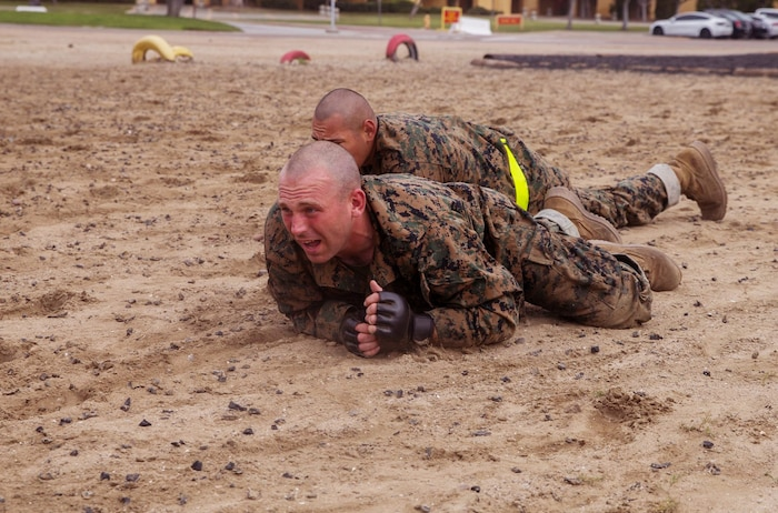 A recruit with Fox Company, 2nd Recruit Training Battalion, low crawls during the Combat Conditioning Course at Marine Corps Recruit Depot, San Diego, April 1, 2020.