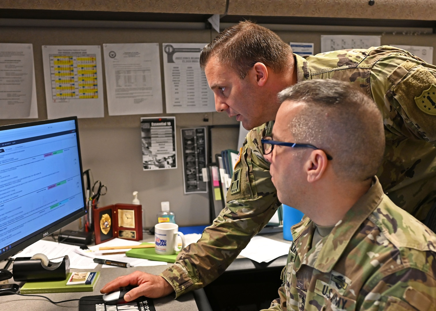 Master Sgt. Robert Valarese and Sgt. 1st Class Dennis Galimberti, NHARNG, monitor current and potential COVID-19 missions from the Joint Operations Center in Concord, N.H.