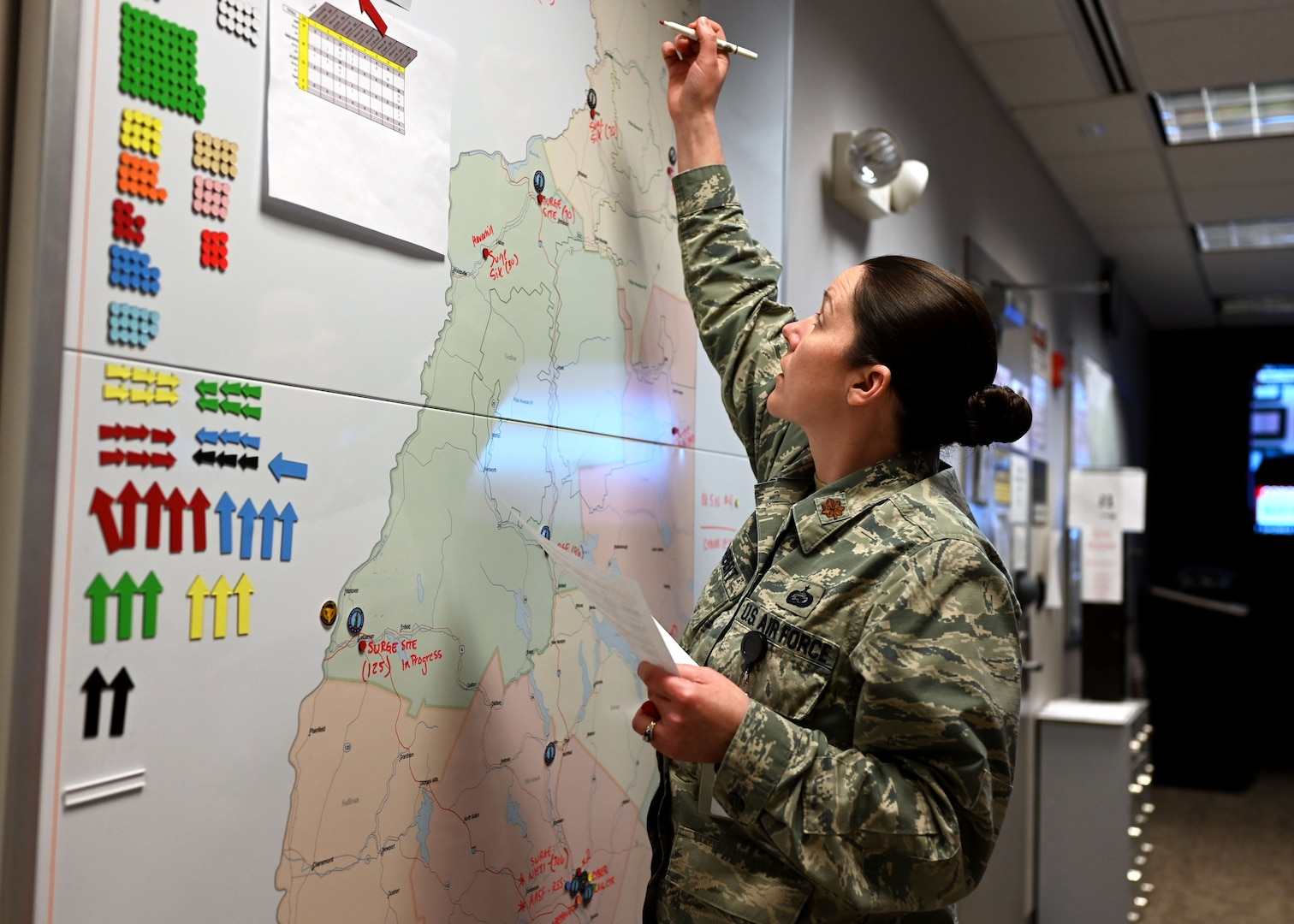 Maj. Moira Cuthbert, chief of operations, New Hampshire National Guard, tracks COVID-19 missions at the Joint Operations Center.