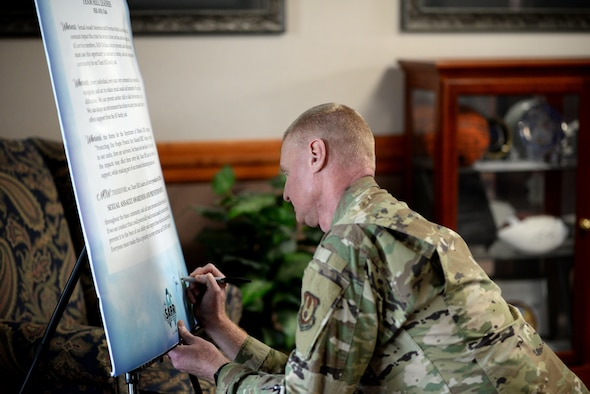 Col. Jon Eberlan, 75th Air Base Wing commander, signs the Sexual Assault Awareness and Prevention Month (SAAPM) proclamation.