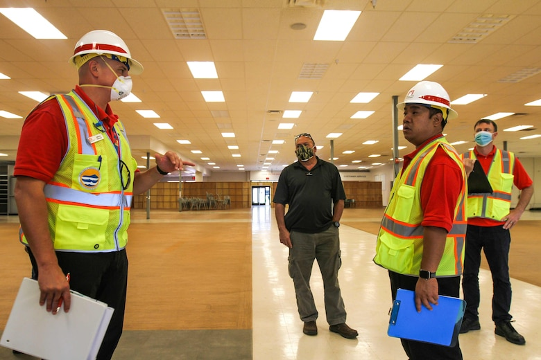 Members from the U.S. Army Corps of Engineers (USACE) Honolulu District discuss plans to transform commercial facilities to alternate-care-facilities in Kauai, Hawaii, April 3, 2020.