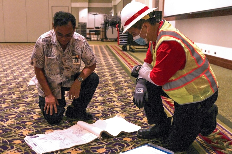 A member of the U.S. Army Corps of Engineers (USACE) Honolulu District discusses the layout of a potential COVID-19 alternate-care-facility in Kauai, Hawaii, April 3, 2020.