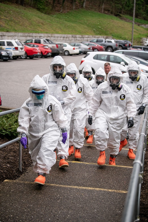 Members of the West Virginia National Guard's Task Force Chemical, Biological, Radiological and Nuclear (CBRN) Response Enterprise (CRE) (TF-CRE) assist staff, medical personnel, and first responders of an Eastbrook Center nursing home with COVID-19 testing April 6, 2020, in Charleston, West Virginia, after a resident tested positive for the pandemic virus. Members donned proper personal protective equipment (PPE) to complete testing on more than 120 residents and 25 staff as part of ongoing operations across West Virginia in support of a whole of government response effort. (U.S. Army National Guard photo by Edwin L. Wriston)