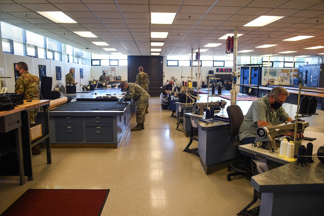 Members of the 62nd Operations Squadron aircrew flight equipment section, along with leaders from other Team McChord units, work to produce cloth face masks for mission-essential personnel at the AFE fabrication shop on Joint Base Lewis-McChord, Wash., April 6, 2020. The Center for Disease Control (CDC) advises the use of simple cloth face coverings to slow the spread of COVID-19. (U.S. Air Force photo by Airman 1st Class Mikayla Heineck)