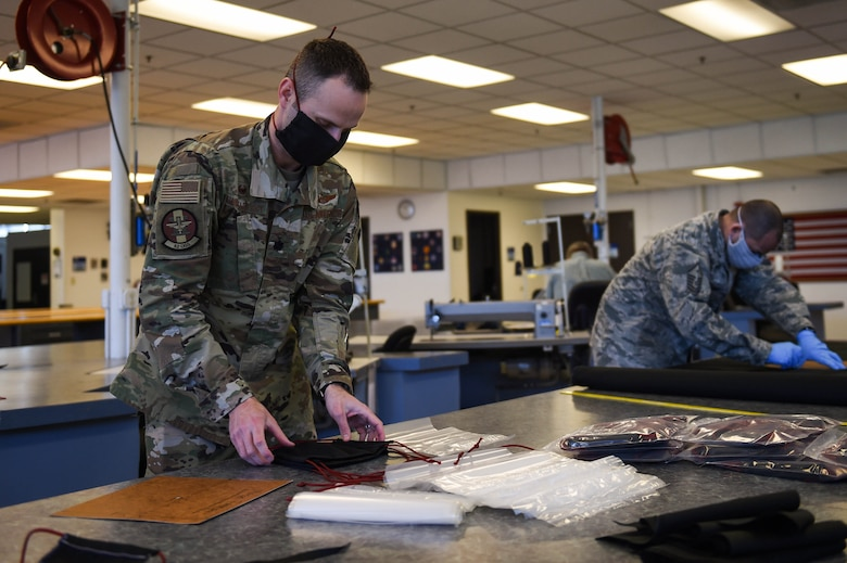Lt. Col. Chris Thackaberry, 62nd Operations Support Squadron commander, packages completed cloth face masks at the 62nd OSS aircrew flight equipment fabrication shop on Joint Base Lewis-McChord, Wash., April 6, 2020. The masks were distributed first to Airmen who come in contact with aircrews most frequently such as maintainers and AFE Airmen. (U.S. Air Force photo by Airman 1st Class Mikayla Heineck)