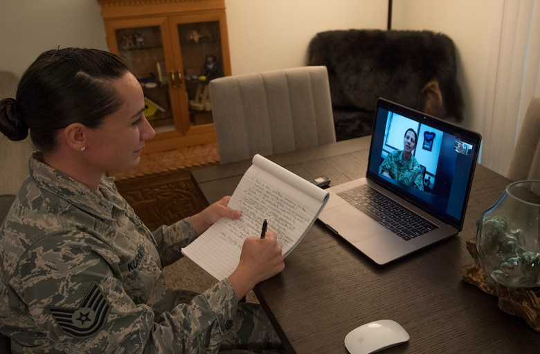 A photo of U.S. Air Force Tech. Sgt. Amber Kurka, 624th Public Affairs photojournalist craftsman, speaking with Col. Athanasia Shinas, the 624th Regional Support Group commander, during a video teleconference interview April 2, 2020, from her home in Mililani, Hawaii, about the unit's upcoming first-ever virtual unit training assembly. Air Force Reserve Airmen in Hawaii and Guam continued mission readiness training during the 624th RSG virtual UTA, which was implemented to help keep Airmen safe during COVID-19 pandemic. (Courtesy Photo)