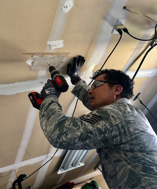 A photo of U.S. Air Force Tech. Sgt. Victor Reinares, a 624th Civil Engineer Squadron structural craftsman, conducting hands-on preplanned component of his training from home in Hawaii as part of the 624th Regional Support Group virtual unit training assembly April 4, 2020. Air Force Reserve Airmen in Hawaii and Guam continued mission readiness training during the first-ever 624th RSG virtual UTA, which was implemented to help keep Airmen safe during COVID-19 pandemic. (Courtesy Photo)
