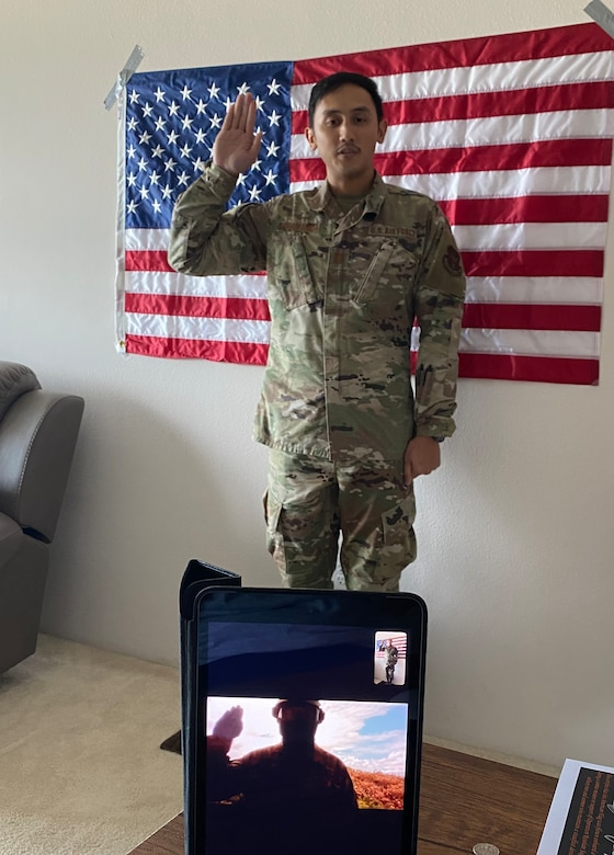 A photo of U.S. Air Force Capt. John Penaranda, the 624th Civil Engineer Squadron readiness flight commander, administering the oath of enlistment via video teleconference during a virtual reenlistment for Tech. Sgt. Miguel Gil, a 624th Civil Engineer Squadron water and fuel systems maintenance craftsman, as part of the 624th Regional Support Group virtual unit training assembly April 4, 2020, from his home in Hawaii. Air Force Reserve Airmen in Hawaii and Guam continued mission readiness training during the first-ever 624th RSG virtual UTA, which was implemented to help keep Airmen safe during COVID-19 pandemic. (Courtesy Photo)