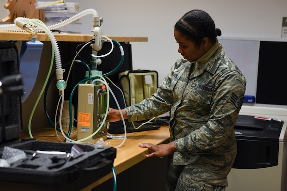 U.S. Air Force Staff Sgt. Neekia Williams, 52nd Medical Group biomedical equipment technician, inspects a ventilator at Spangdahlem Air Base, Germany, April 1, 2020. Williams ensures ventilators are working properly if needed for COVID-19 care. (U.S. Air Force photo by Senior Airman Melody W. Howley)