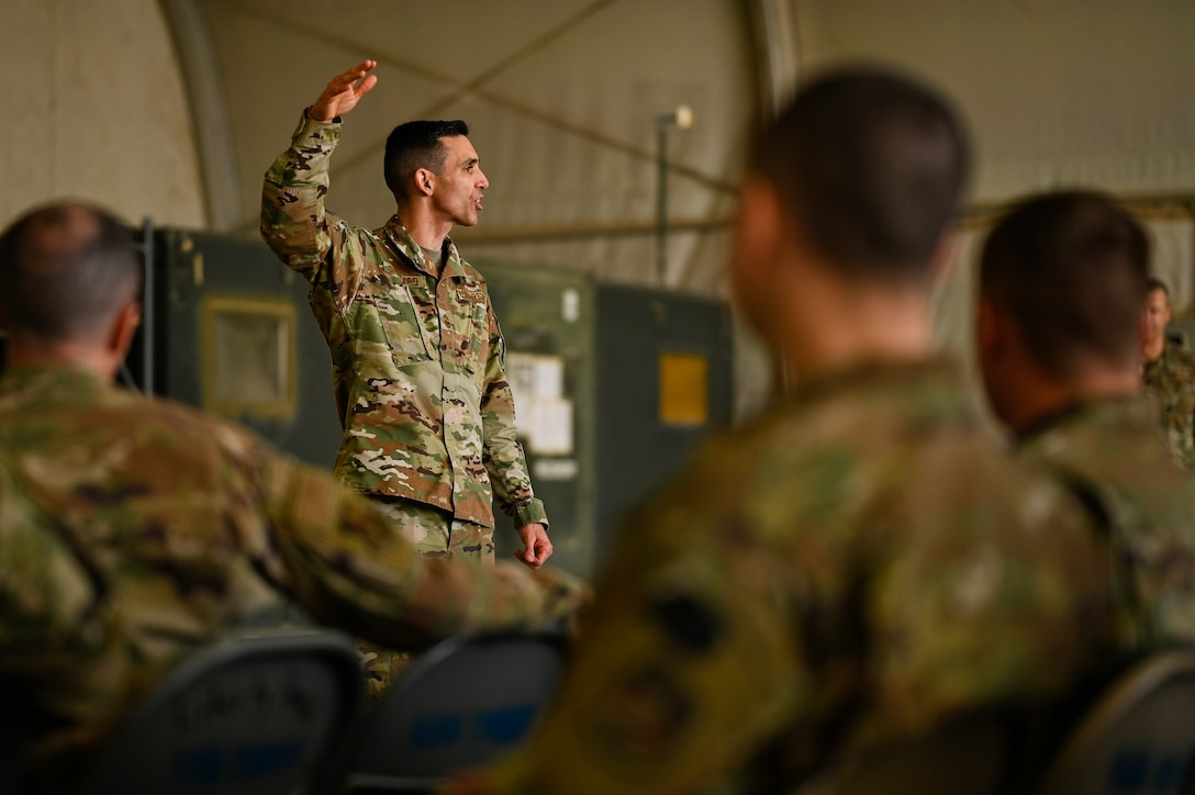 U.S. Air Force Chief Master Sgt. Shawn L. Drinkard, Command Chief Master Sgt. for U.S. Air Forces Central Command, speaks with 451st Air Expeditionary Group Airmen at Kandahar Airfield about the importance of the USAFCENT mission in Afghanistan, Feb. 24, 2020.