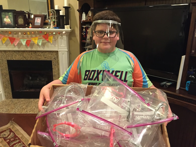 "Evan Meier, the son of Thomas and Katherine Meier, and 6th grade student uses his 3D printer to create face masks and face shields for local hospital workers. Inspired by his aunt and YouTube program, ""Smarter Every Day,"" the youth joined forces with 235 other Huntsville, Alabama, volunteers to make over 3,800 shields for area health care and first responders treating COVID-19 patients."