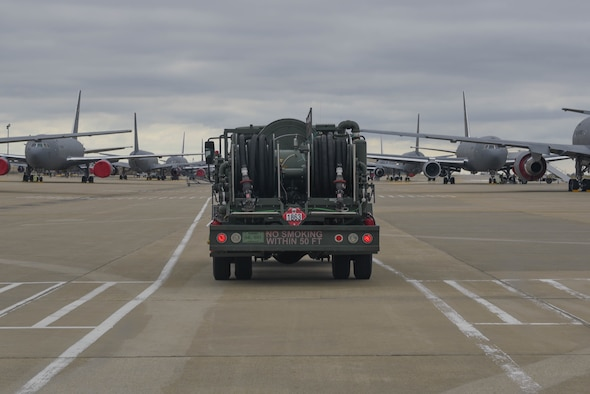 A petroleum, oil and lubricants truck drives to refuel a KC-46 Pegasus on the flightline March 24, 2020, at McConnell Air Force Base, Kansas. POL services McConnell's 55 aircraft and offloads approximately 75,000 gallons of Jet A fuel daily supporting aerial refueling operations. (U.S. Air Force photo by Senior Airman Alexi Bosarge)