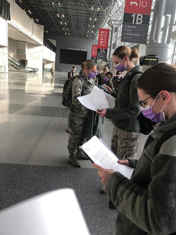 Seven Reserve Citizen Airmen from the 445th Aerospace Medicine and 445th Aeromedical Staging Squadrons in-process April 7, 2020 after deploying to Manhattan, New York City, where they are joining medical professionals from the civilian sector and all components of the armed services in response to COVID-19. The doctor, nurse practitioner and five nurses left Ohio April 5, 2020 and will be working in the Jacob K. Javits Center, a 2.1-million-square-foot convention center converted into a makeshift hospital in Manhattan, New York City. The 24-hour field hospital currently boasts 3,000 beds solely for individuals potentially exposed to, or confirmed ill with, COVID-19.