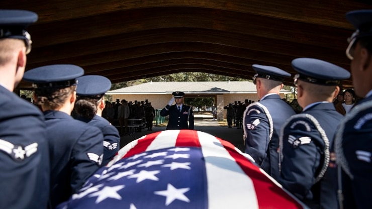Staff Sgt. Jourdan Clark, 96th Medical Group, salutes as pallbearers carry the casket during the Honor Guard graduation ceremony, March 6, at Eglin Air Force Base, Fla.