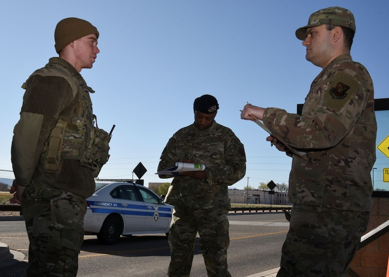 A team asks questions to a security forces member at the Truman Gate