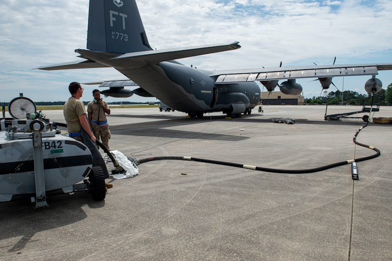 Photo of Airmen performing an in-flight refueling hose change.