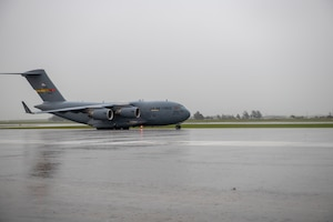 A C-17 taxis on the flight line.