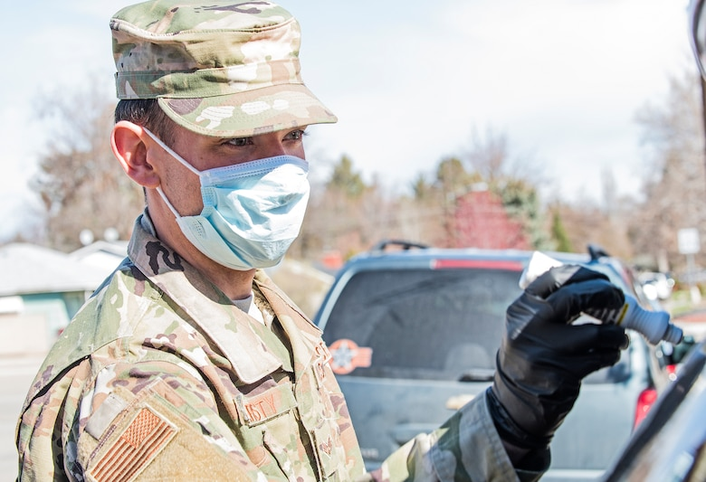 Senior Airman Nicholas Christy from the 124th Fighter Wing, Idaho National Guard, and the other Airmen are helping out at Idaho food banks by unloading food from trucks, sorting the food into carts and helping load the donated food into people's cars April 3, 2020.