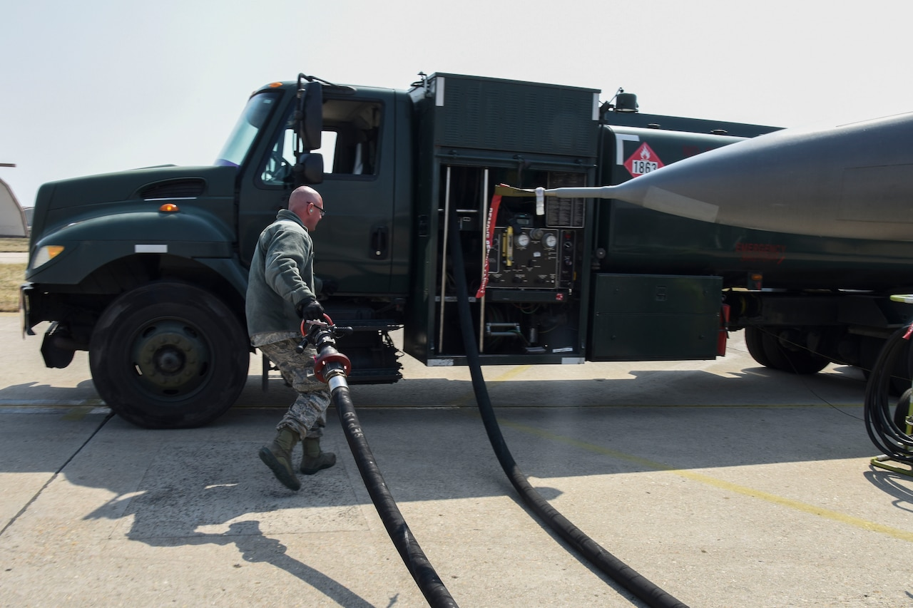 U.S. Air Force Tech. Sgt. Kevin Neiferd, 8th Logistics Readiness Squadron fuels distribution NCO in charge, puts away a hose after refueling an F-16 Fighting Falcon aircraft at Kunsan Air Base, Republic of Korea, April 3, 2020. The 8th LRS fuels management flight's mission is to verify the quality of all fuel that comes in and out of the base to ensure the 8th Fighter Wing is always mission ready. (U.S. Air Force photo by Senior Airman Jessica Blair)