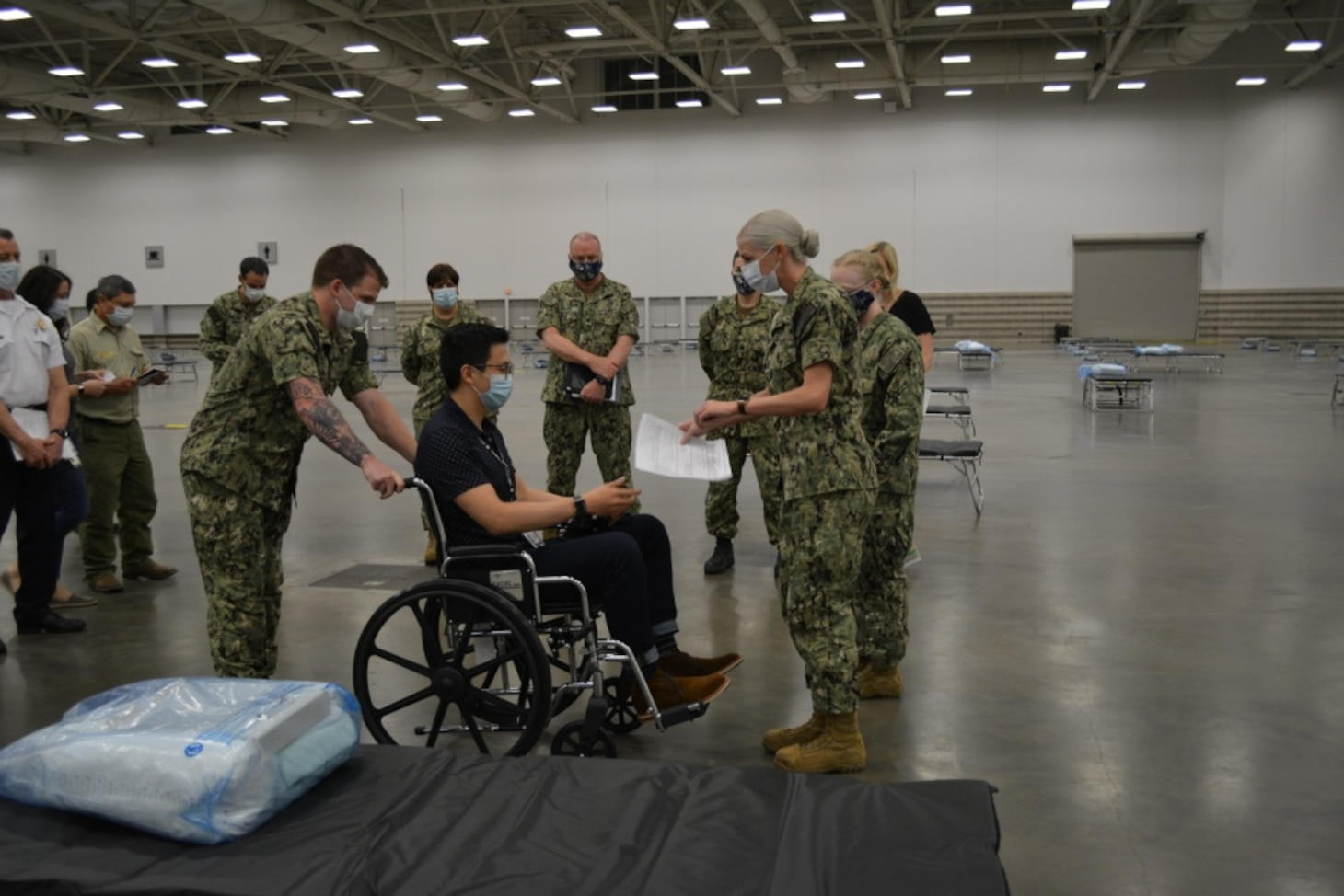 Sailors assigned to the Expeditionary Medical Facility-M, officials from the Federal Emergency Management Agency and the Department of Health and Human Services conduct a patient scenario exercise in Dallas, Texas in support of the Department of Defense COVID-19 response.