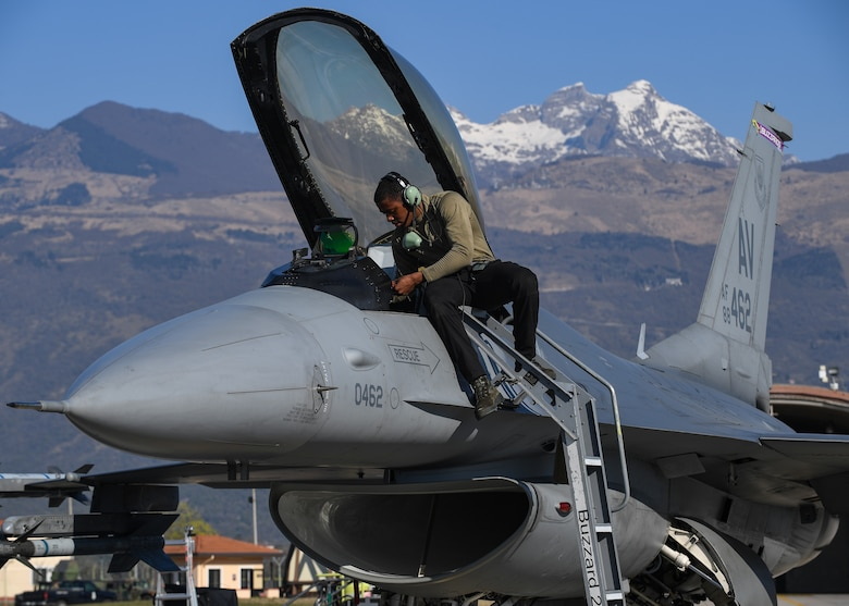 U.S. Air Force Airman Jaquinton Stewart, crew chief for the 510th Fighter Squadron, performs preflight procedures at Aviano Air Base, Italy, Apr. 7, 2020. In alignment with the new decrees put in place by the Italian government, crew chiefs at Aviano continue to ensure that the aircraft in their care is ready to fly at a moment's notice so that pilots can safely and effectively complete their mission. (U.S Air Force photo by Airman Thomas S. Keisler IV)
