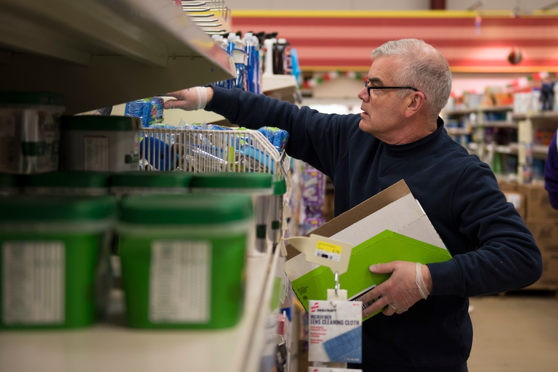 RAF Alconbury and RAF Molesworth employees and volunteers restock shelves at the base commissary at RAF Alconbury England, March 20, 2020. Volunteers answered the call to support the community to ensure service members and their families had access to essential items amid COVID-19. (U.S. Air Force photo by Airman 1st Class Jennifer Zima)