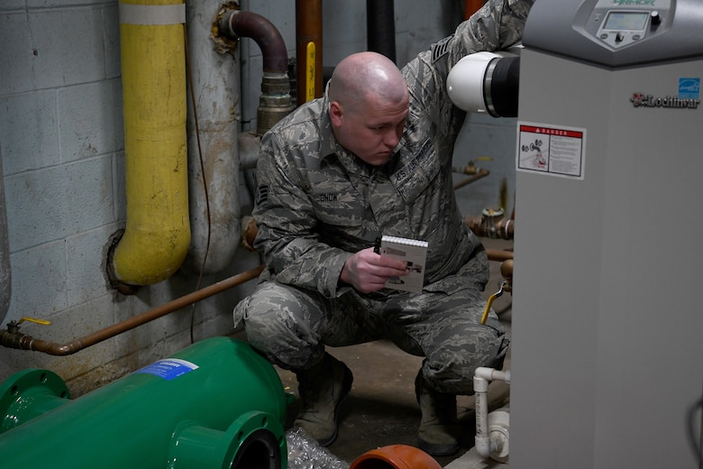 U.S. Air Force Staff Sgt. David Show, an HVAC craftsman with the Ohio National Guard's 200th RED HORSE (Rapid Engineer Deployable Heavy Operational Repair Squadron Engineers) Squadron and currently assigned to the Northwest Joint Engineer Assessment Team, surveys the boiler room at Upper Sandusky High School April 4, 2020, in Upper Sandusky, Ohio. Guard members conducted a site survey at the high school to determine whether it is suitable for potential use as an alternate medical facility, if COVID-19 cases increase beyond what existing hospitals in the state can manage.