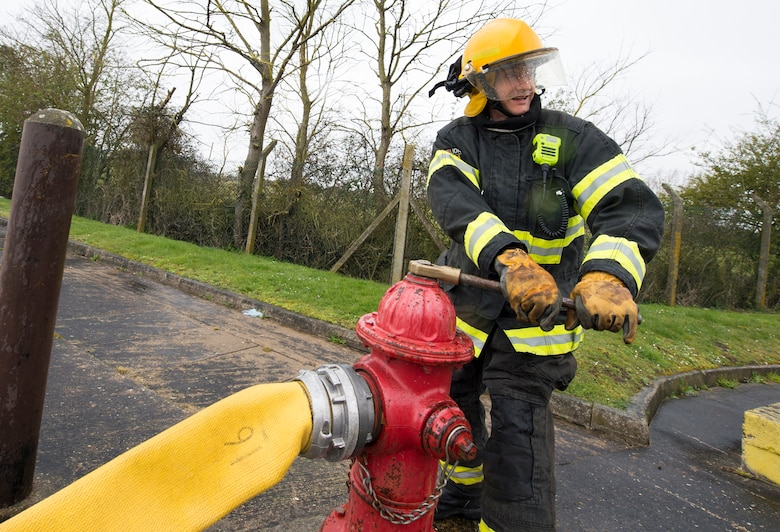A firefighter with the 423rd Civil Engineer Squadron turns on a fire hydrant during confined spaces training at RAF Alconbury, England on March 30, 2020. This type of training helps the firefighters maintain readiness and stay proficient in their craft. (U.S. Air Force photo by Master Sgt. Brian Kimball)