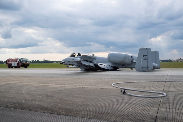 A photo of an A-10C Thunderbolt II aircraft sitting on the runway.