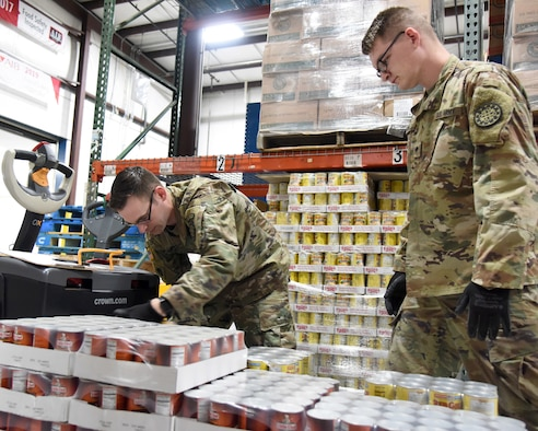 The Michigan Guard Soldiers assisted by packing food boxes for distribution for those in need.