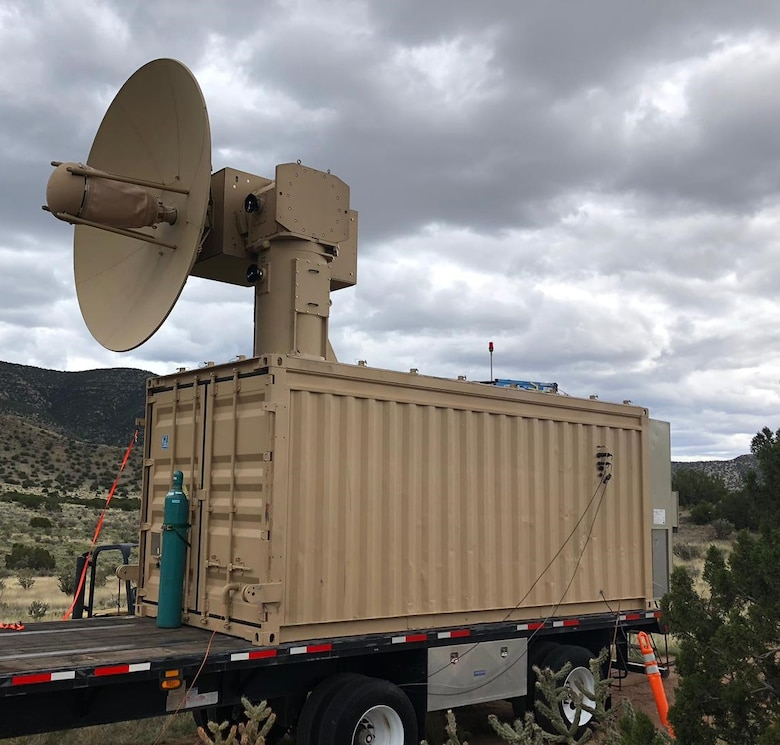 photo of military laser dish on top of shipping container
