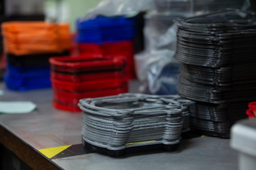 A 3D printer produces face mask frames.