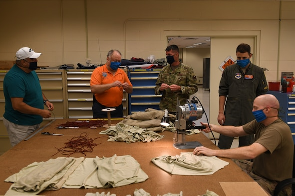 ALTUS AIR FORCE BASE, Okla. - Members of the 97th Operations Support Squadron, Air Crew Flight Equipment (AFE) flight, assemble face masks for base members, April 6, 2020 at Altus Air Force Base Oklahoma.