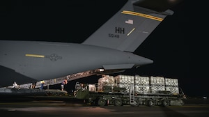 U.S. Air Force Airmen and civilians from the 735th Air Mobility Squadron load COVID-19 personal protective equipment and medical supplies onto a C-17 Globemaster III from the 535th Airlift Squadron at Joint Base Pearl Harbor-Hickam, Hawaii, April  3, 2020. The 735th Air Mobility Squadron loaded 31,063 pounds of cargo containing COVID-19 personal protective equipment and medical supplies from the CDC and FEMA that were delivered to the Mariana Islands.   (U.S. Air Force photo by Tech. Sgt. Anthony Nelson Jr.)