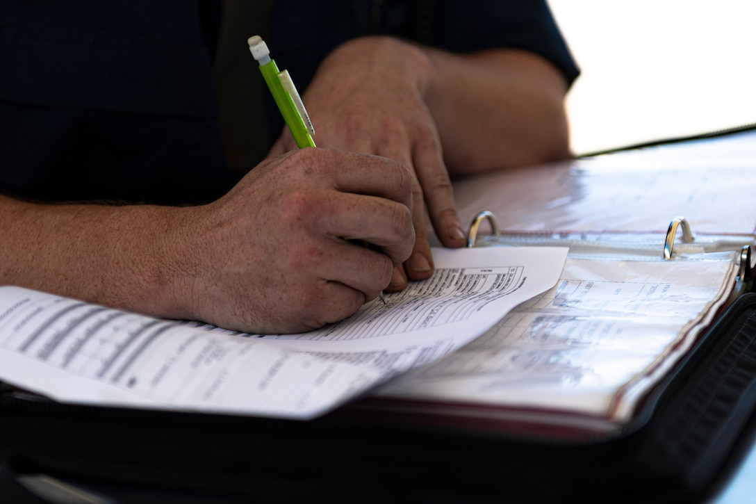 A photo of an Airman filling out paperwork